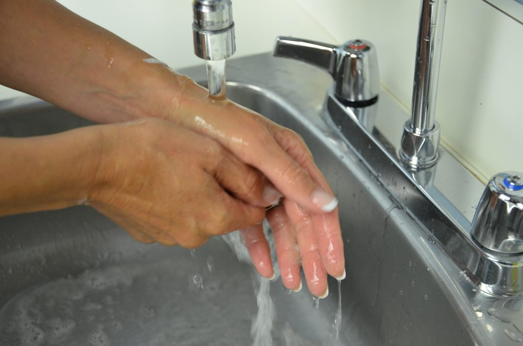 How to Dry Nail Polish Faster - Keep Hands Under Running Water